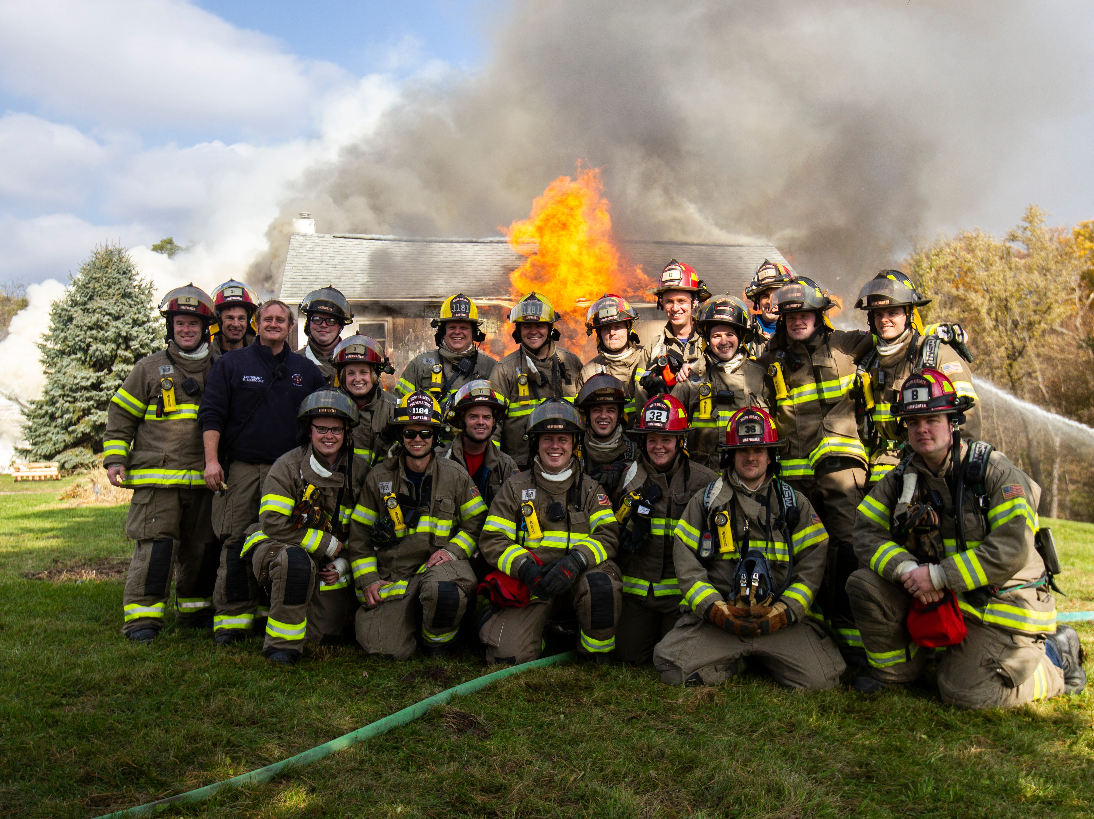 North Liberty Fire Department members pose for a photo during a fire training exercise of a farm house on Saturday, Oct. 27, 2018, on the east side of Liberty High School in North Liberty.
