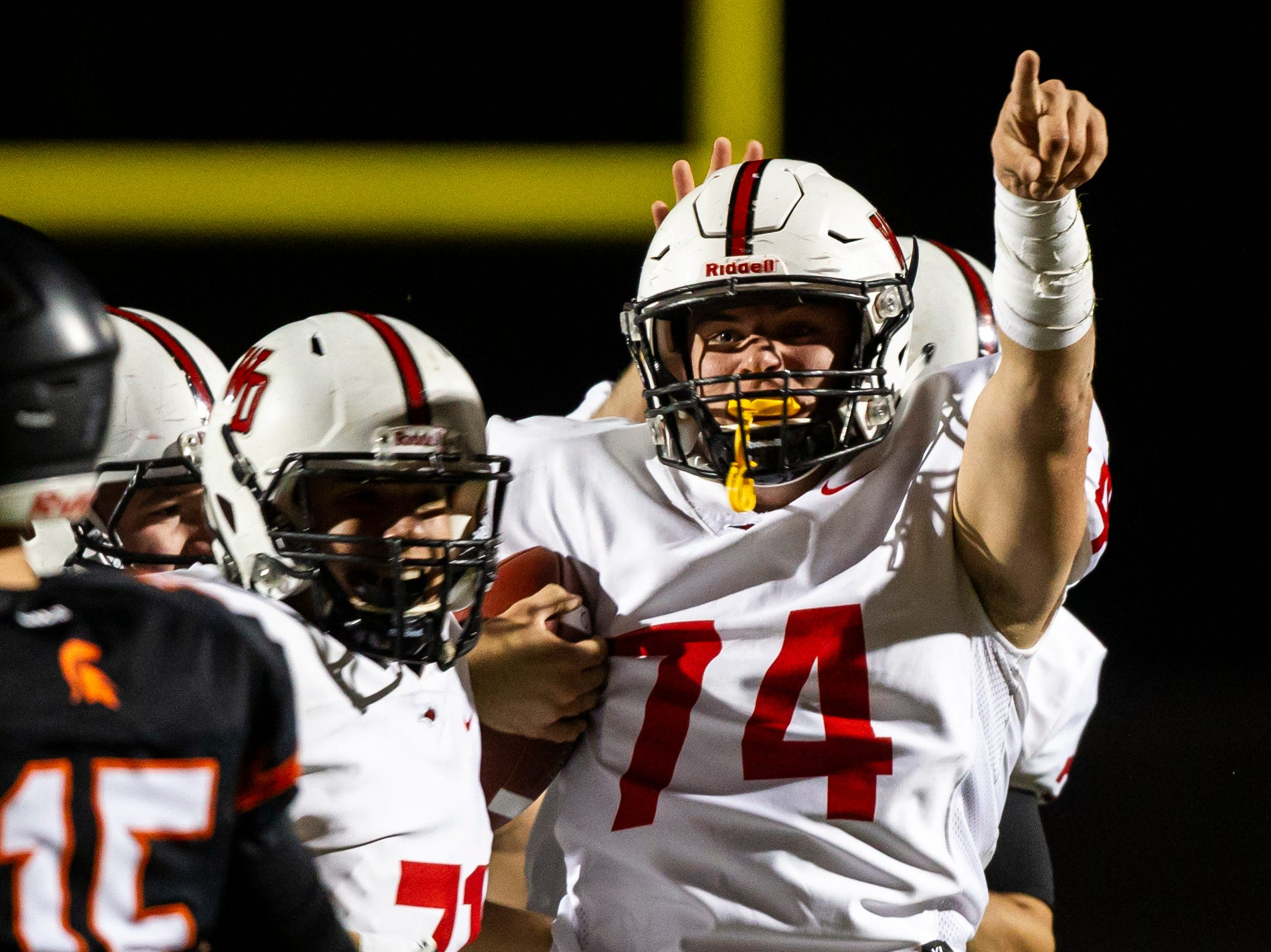 Western Dubuque's Justin Kluesner (74) celebrates after recovering a fumble during a Class 3A varsity first round playoff football game on Friday, Oct. 26, 2018, at Spartan Stadium in Solon, Iowa.