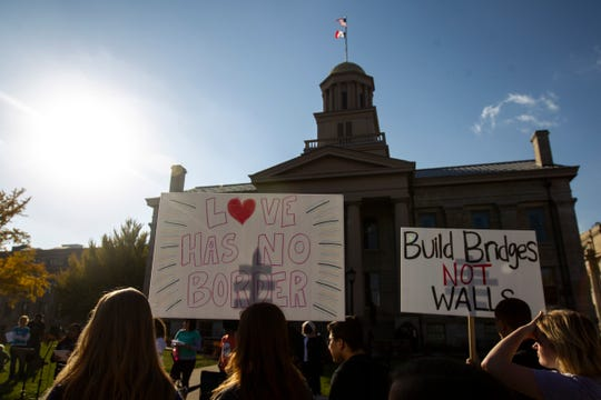"Community members gather during the ""Rally for Immigration Reform"" on Saturday, Oct. 27, 2018, on the east side the Pentacrest in Iowa City."