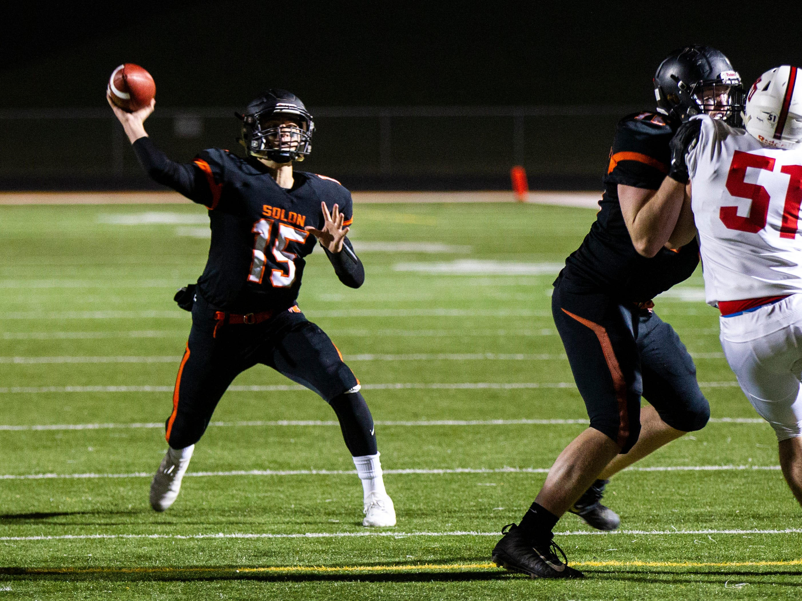 Solon's Mathieux Rehnke passes during a Class 3A varsity first round playoff football game on Friday, Oct. 26, 2018, at Spartan Stadium in Solon, Iowa.