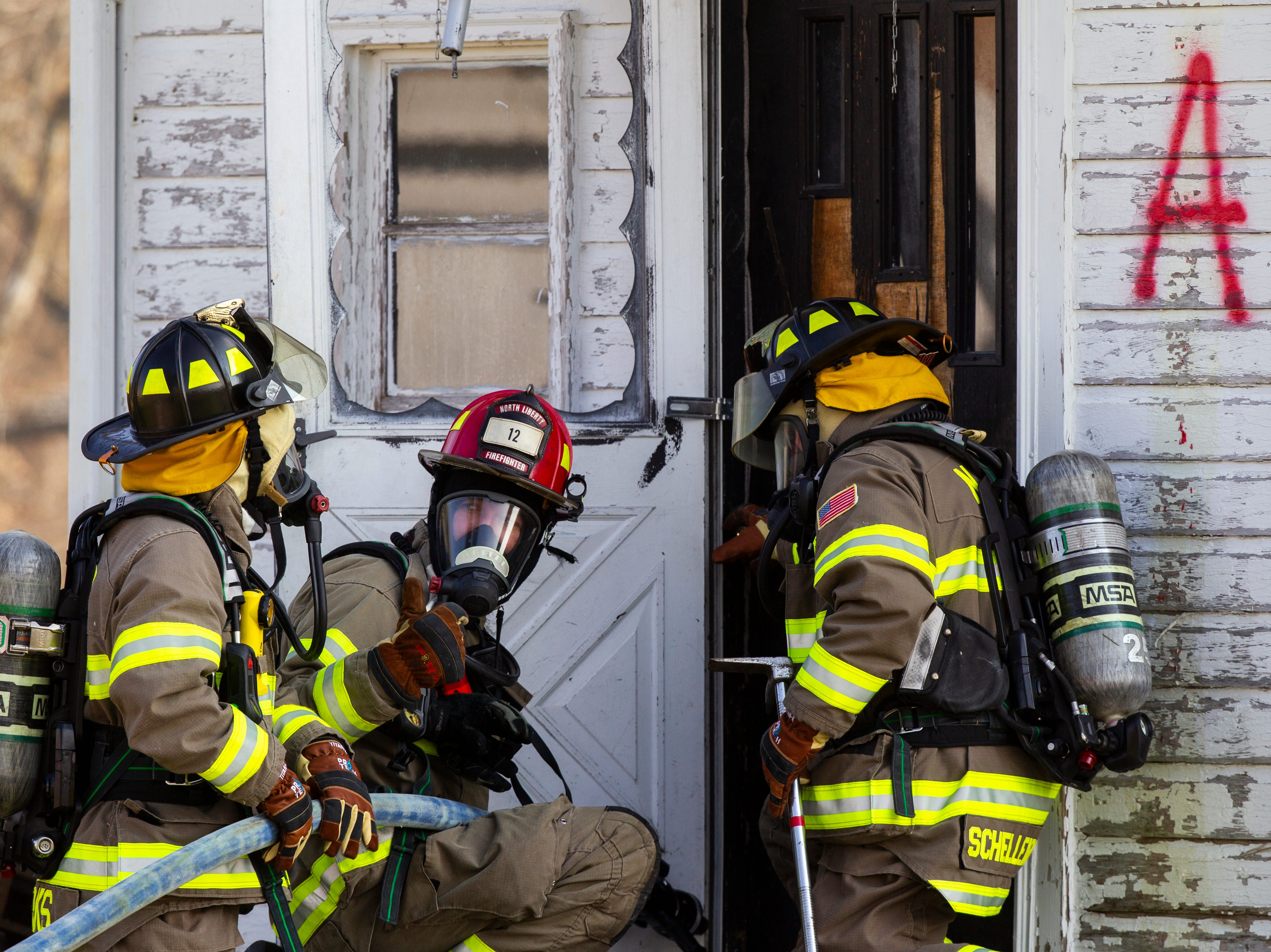North Liberty Fire Department conducts a fire training exercise of a farm house on Saturday, Oct. 27, 2018, on the east side of Liberty High School in North Liberty.