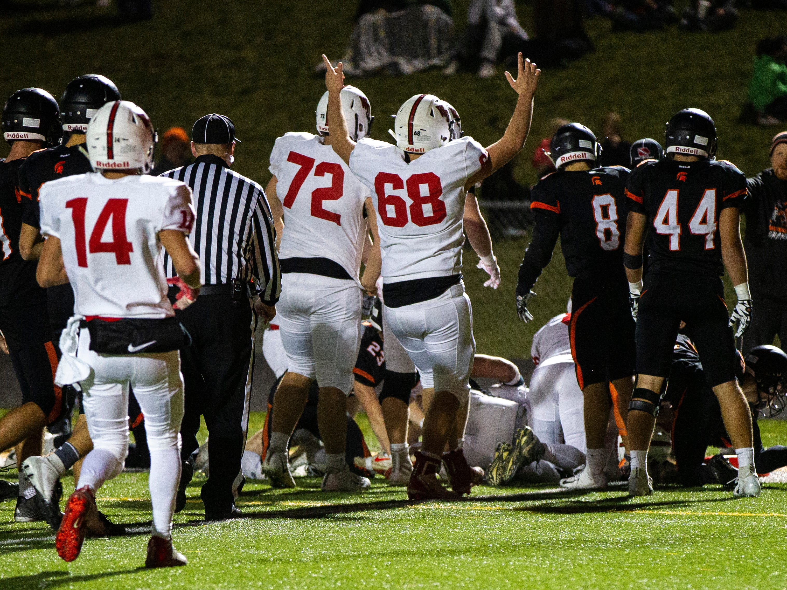 Western Dubuque players celebrate a touchdown during a Class 3A varsity first round playoff football game on Friday, Oct. 26, 2018, at Spartan Stadium in Solon, Iowa.