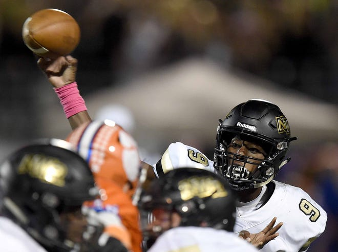 Northwest Rankin quarterback Jamari Jones (9) throws over the Madison Central pass rush on Friday, October 26, 2018, at Madison Central High School in Madison, Miss.