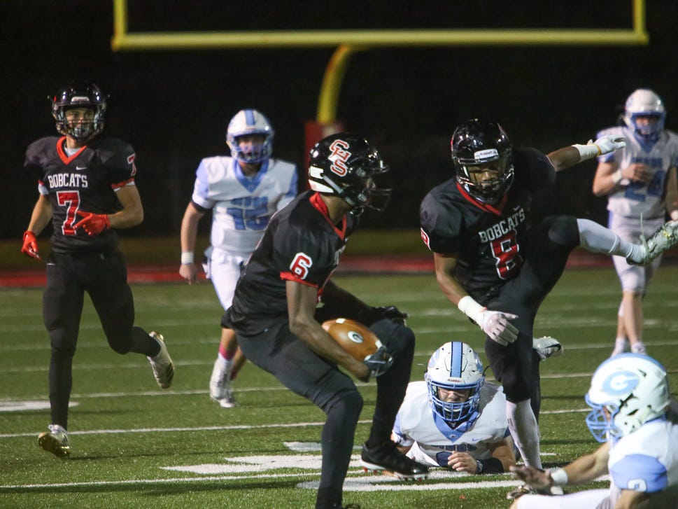 Central's Central's Demetrien Johnson (6) spins lose the Gibbs' players tailing him while teammate Daunte Holliday (8) blocks for him during the Central versus Gibbs high school football game at Central high school in Knoxville Friday Oct. 26, 2018.