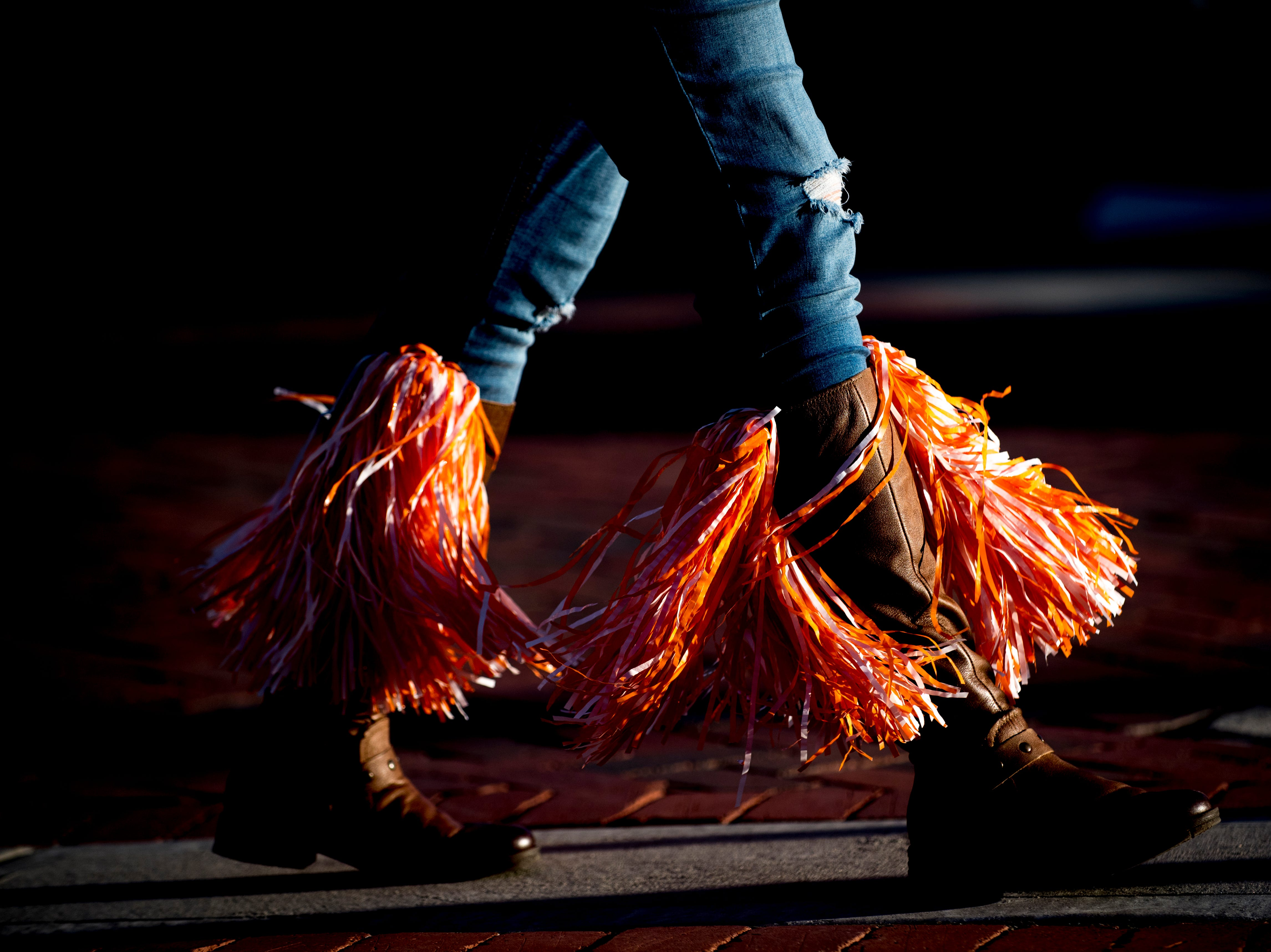 Shanon Estep, of Knoxville, wears pom poms in her boots before a game between Tennessee and South Carolina at Williams-Brice Stadium in Columbia, South Carolina on Saturday, October 27, 2018.