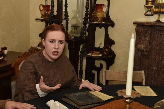 Madame Blavatsky, right, summons a spirit during the seance experience at Mabry-Hazen on Friday, Oct. 26.