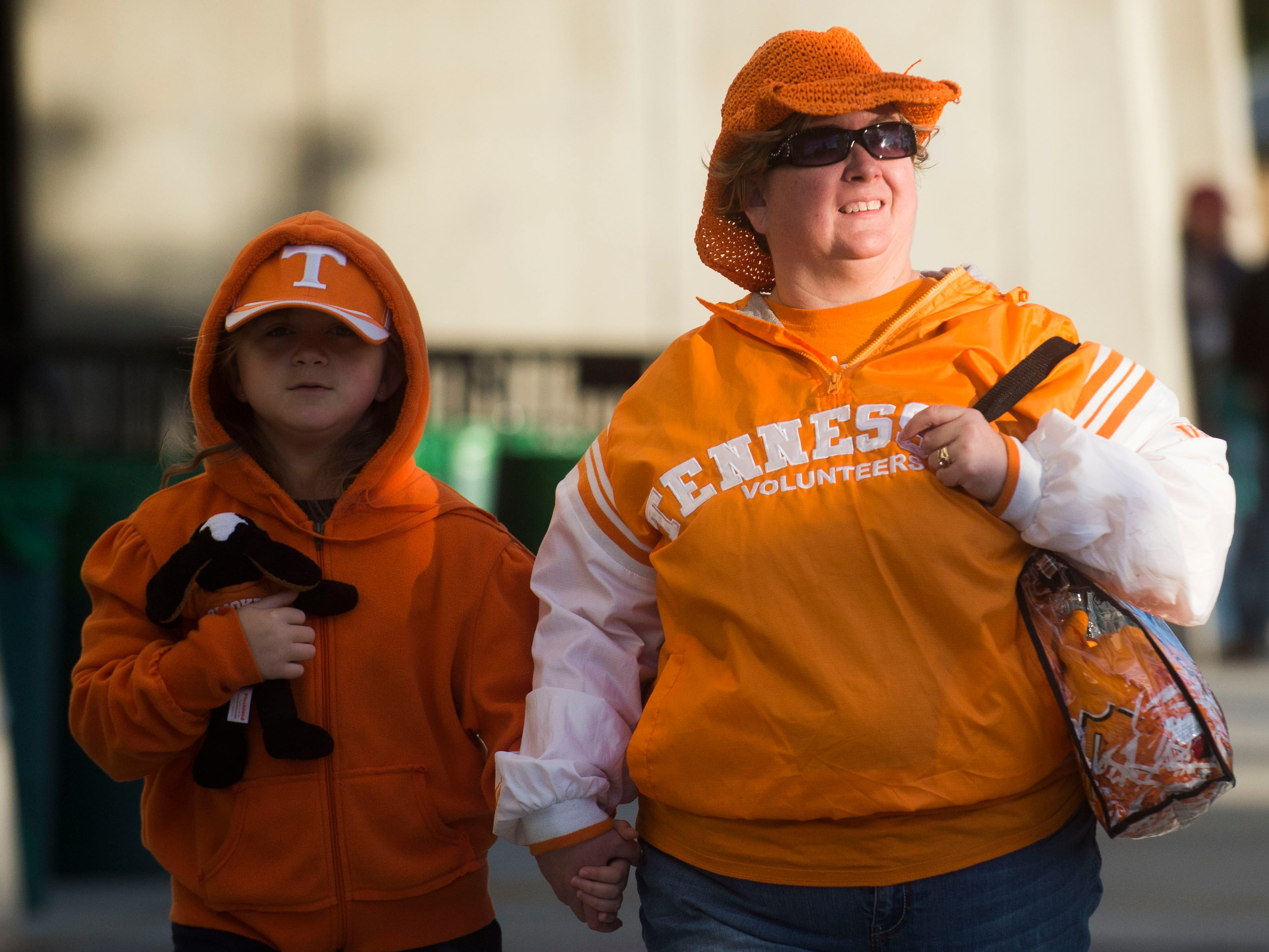 Alexis McGannon, 8, and her mom Carrie of Jasper, Tenn. walk around before a game between Tennessee and South Carolina at Williams-Brice Stadium Saturday, Oct. 27, 2018. This is Alexis' first game.