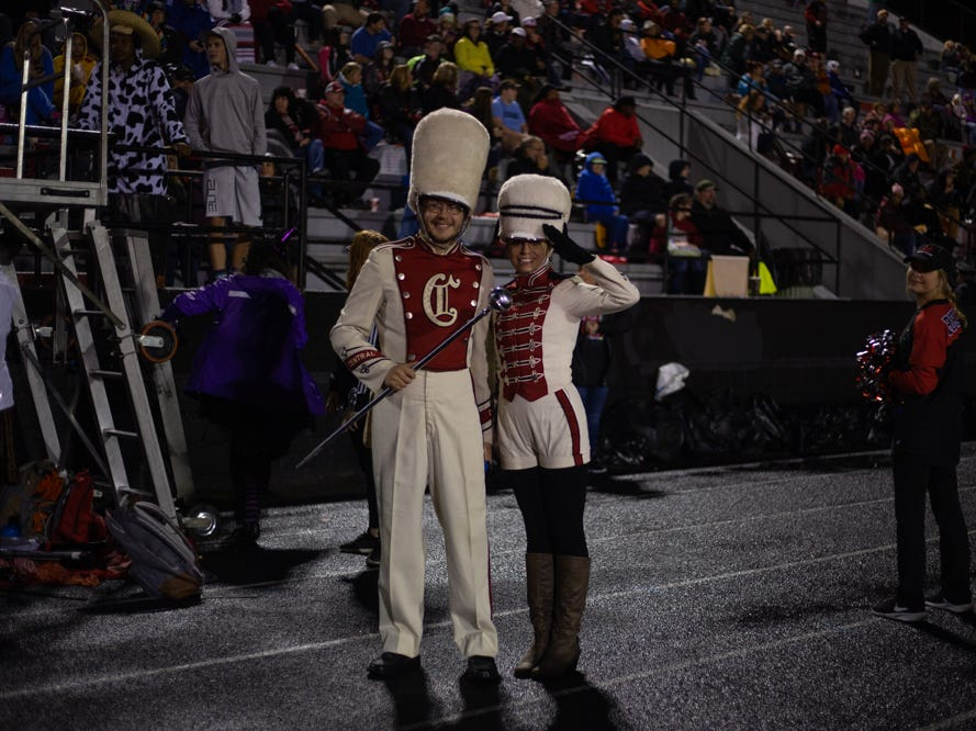 Central high school band directors Alex Mink (left) of Knoxville and Krista Kearney of St. Louis pose in their 1970's Central high school band uniforms during the Central versus Gibbs high school football game at Central high school in Knoxville Friday Oct. 26, 2018.