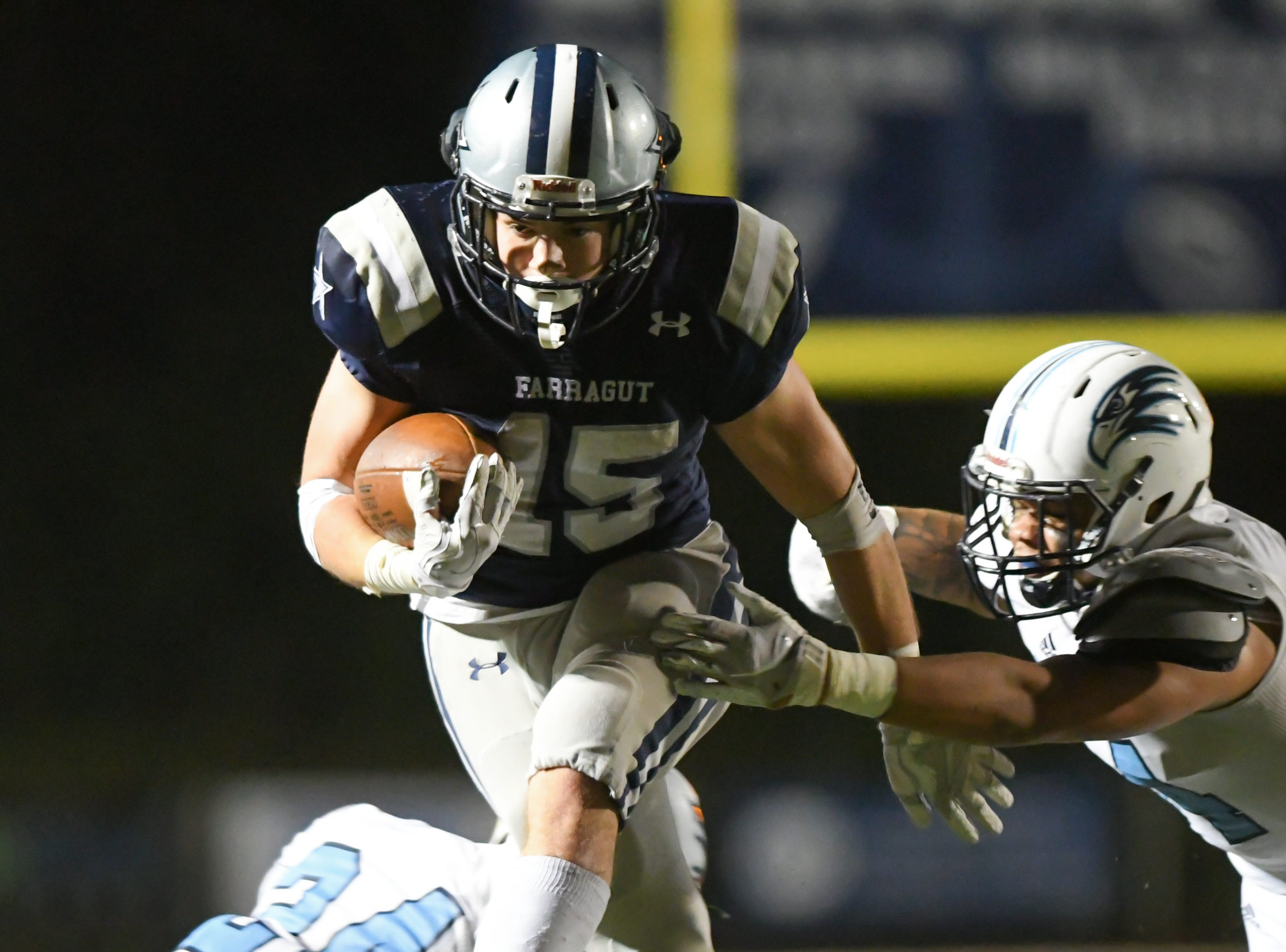 Farragut's Kyle Carter (15) runs with the ball against Hardin Valley during the football game at Farragut on Friday, Oct. 26, 2018