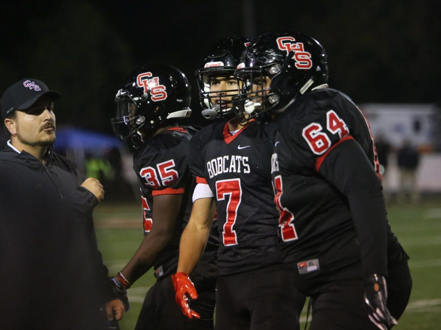 Central's Braden Gaston (7) helps teammate Kross Smith (64) to the sidelines  during the Central versus Gibbs high school football game at Central high school in Knoxville Friday Oct. 26, 2018.