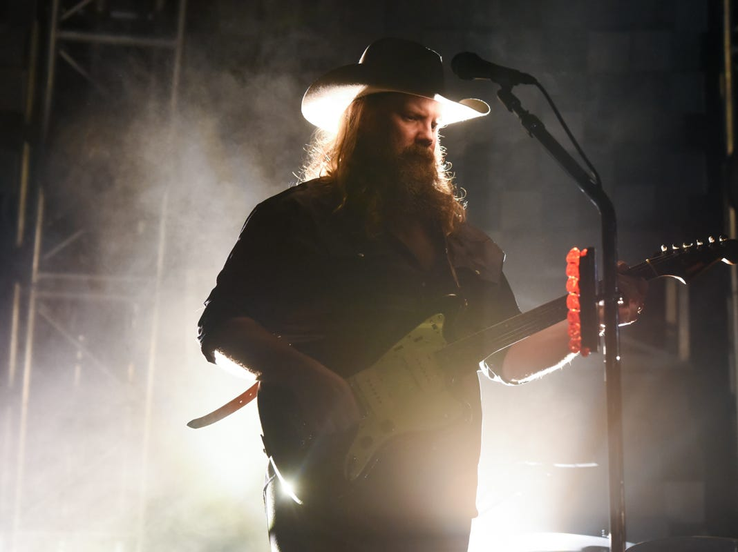 Chris Stapleton and his band perform at Knoxville's Thompson Boling arena on Friday, Oct. 26, 2018.
