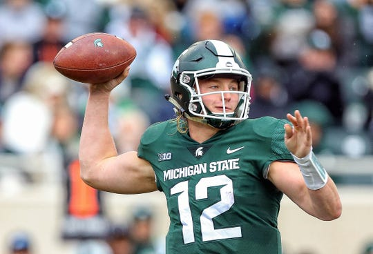 Oct 27, 2018; East Lansing, MI, USA; Michigan State Spartans quarterback Rocky Lombardi (12) drops back to pass the ball during the first half of a game against the Purdue Boilermakers at Spartan Stadium. Mandatory Credit: Mike Carter-USA TODAY Sports