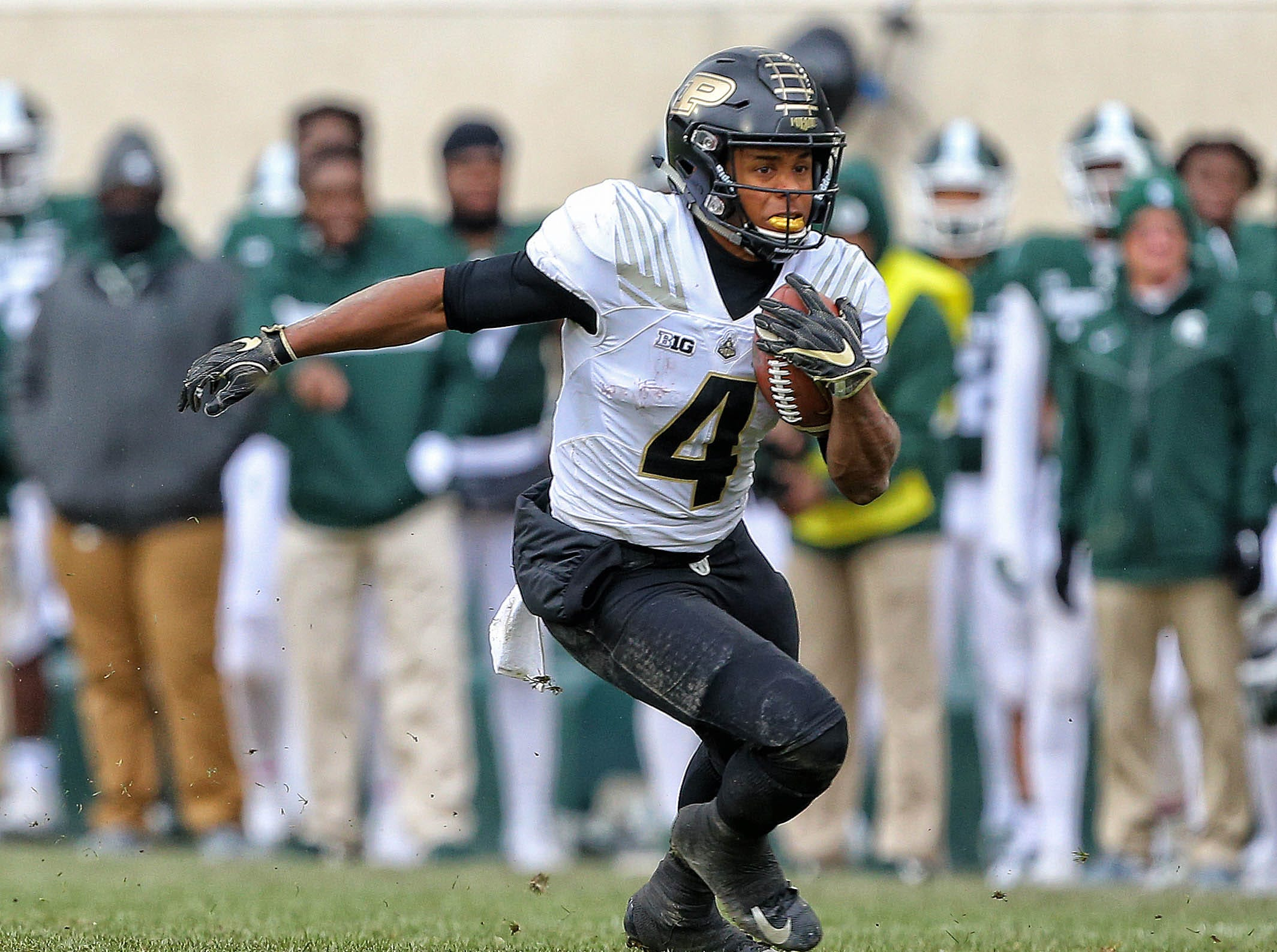 Oct 27, 2018; East Lansing, MI, USA; Purdue Boilermakers wide receiver Rondale Moore (4) runs the ball during the second half of a game against the Michigan State Spartans at Spartan Stadium. Mandatory Credit: Mike Carter-USA TODAY Sports