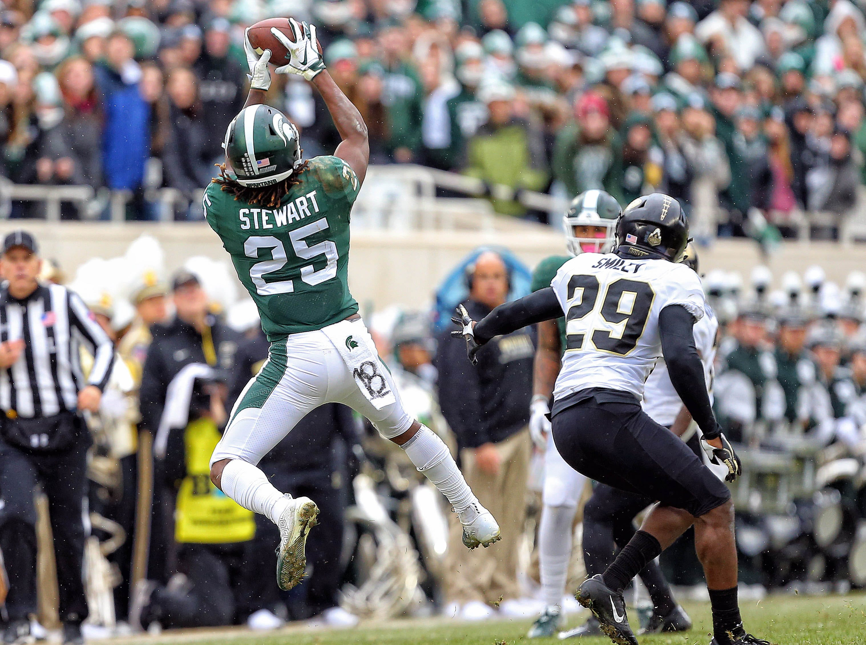 Michigan State Spartans wide receiver Darrell Stewart Jr. (25) makes a catch against Purdue Boilermakers cornerback Simeon Smiley (29) during the first half of a game at Spartan Stadium on Oct. 27, 2018.