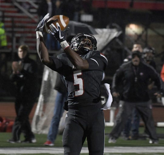 Lafayette Jefferson's Brian Jenkins hauls in a touchdown catch against Noblesville in the Bronchos 35-24 sectional win on Friday October 26, 2018.