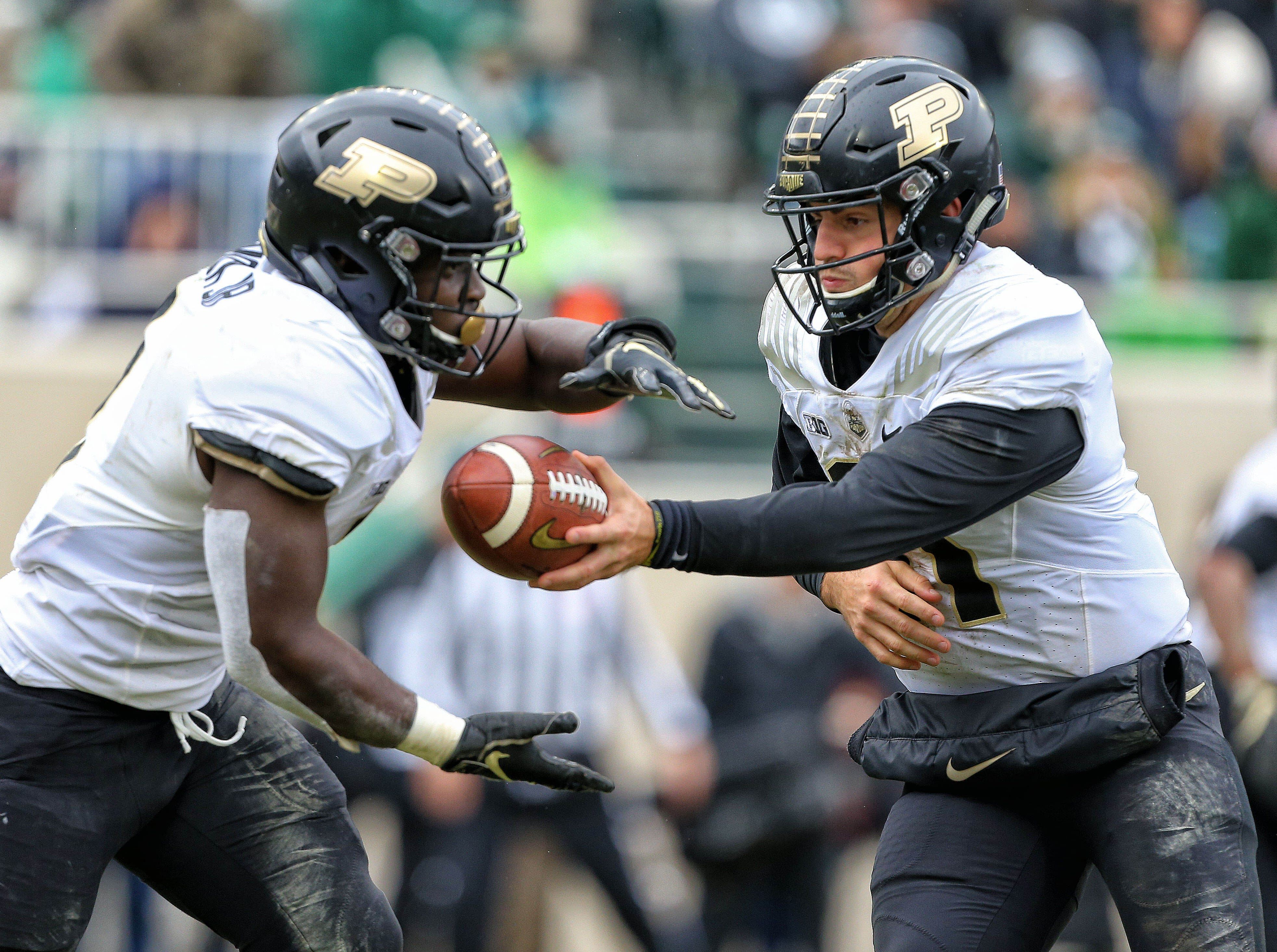 Oct 27, 2018; East Lansing, MI, USA; Purdue Boilermakers quarterback David Blough (11) hands the ball off to Purdue Boilermakers running back D.J. Knox (1) during the second half of a game at Spartan Stadium. Mandatory Credit: Mike Carter-USA TODAY Sports