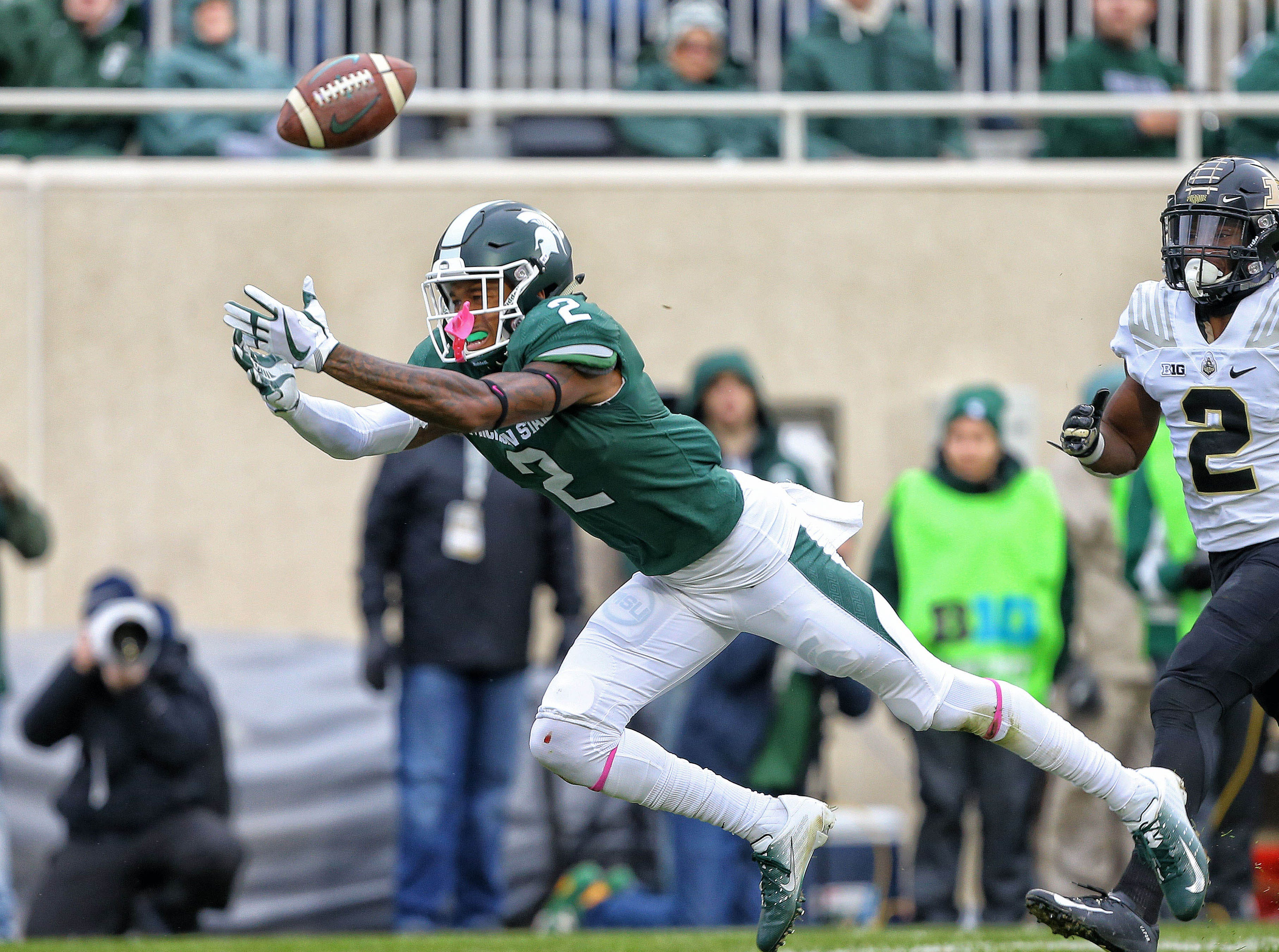 Oct 27, 2018; East Lansing, MI, USA; Michigan State Spartans cornerback Justin Layne (2) attempts to make a catch during the first quarter of a game against the Purdue Boilermakers at Spartan Stadium. Mandatory Credit: Mike Carter-USA TODAY Sports