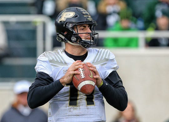 Oct 27, 2018; East Lansing, MI, USA; Purdue Boilermakers quarterback David Blough (11) drops back to pass the ball during the second half of a game against the Michigan State Spartans at Spartan Stadium. Mandatory Credit: Mike Carter-USA TODAY Sports