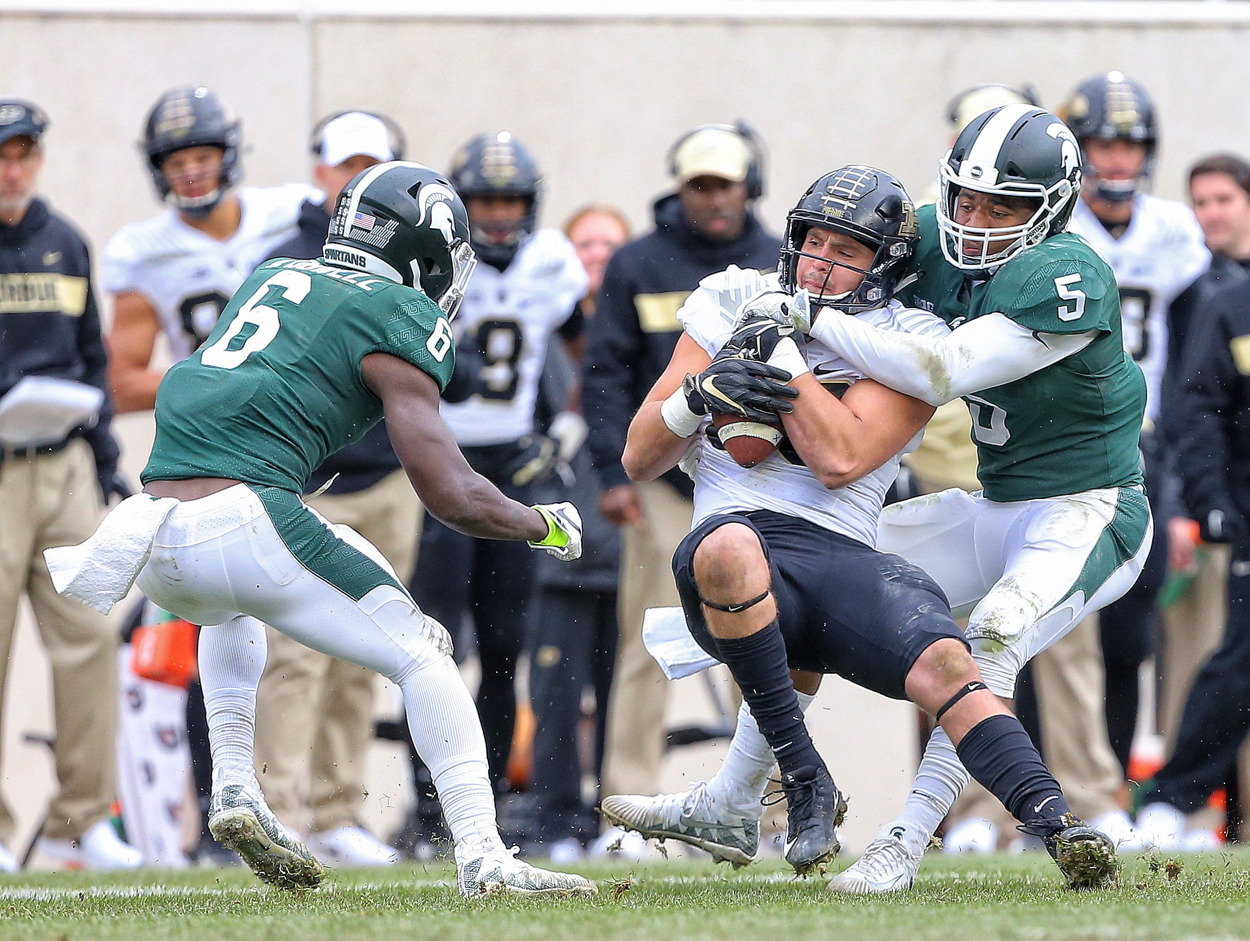 Oct 27, 2018; East Lansing, MI, USA; Purdue Boilermakers tight end Brycen Hopkins (89) is tackled by Michigan State Spartans linebacker Andrew Dowell (5) during the first quarter at Spartan Stadium. Mandatory Credit: Mike Carter-USA TODAY Sports