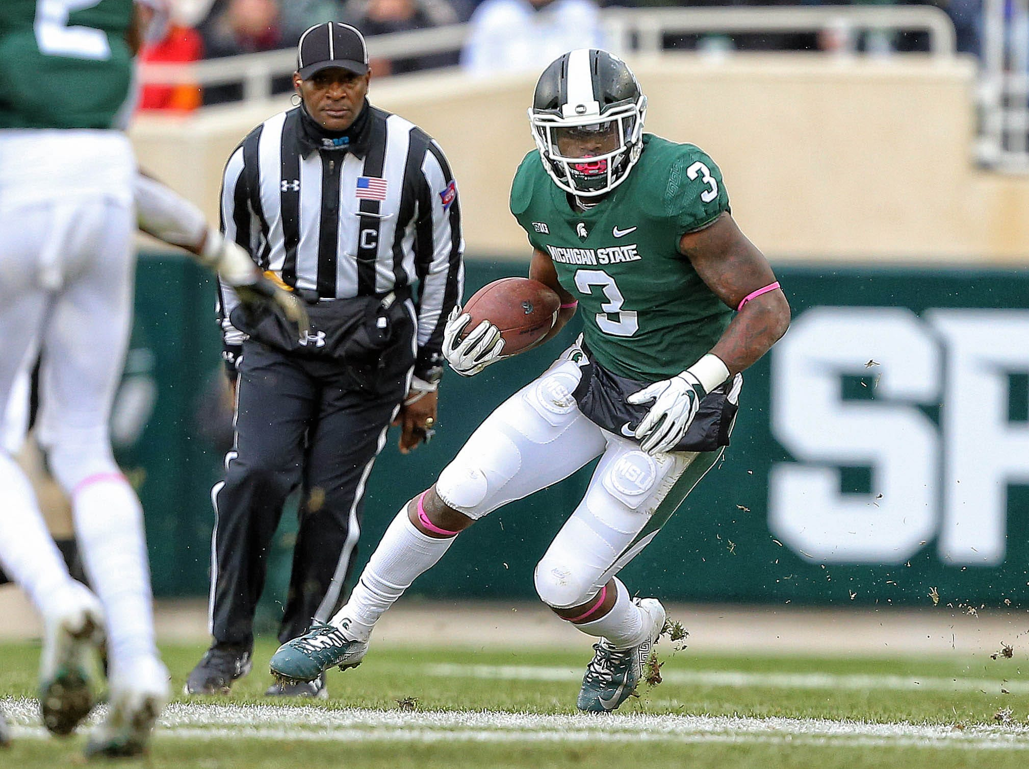 Oct 27, 2018; East Lansing, MI, USA; Michigan State Spartans running back LJ Scott (3) runs the ball during the first half of a game against the Purdue Boilermakers at Spartan Stadium. Mandatory Credit: Mike Carter-USA TODAY Sports
