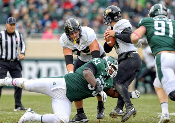 Purdue Boilermakers quarterback David Blough (11) is sacked by Michigan State Spartans defensive tackle Naquan Jones (93) during the first half of a game at Spartan Stadium on Oct. 27, 2018.