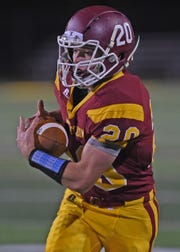 McCutcheon junior Garrett Maish pulls the long pass in and turns for the goal Friday against the Wildkats.