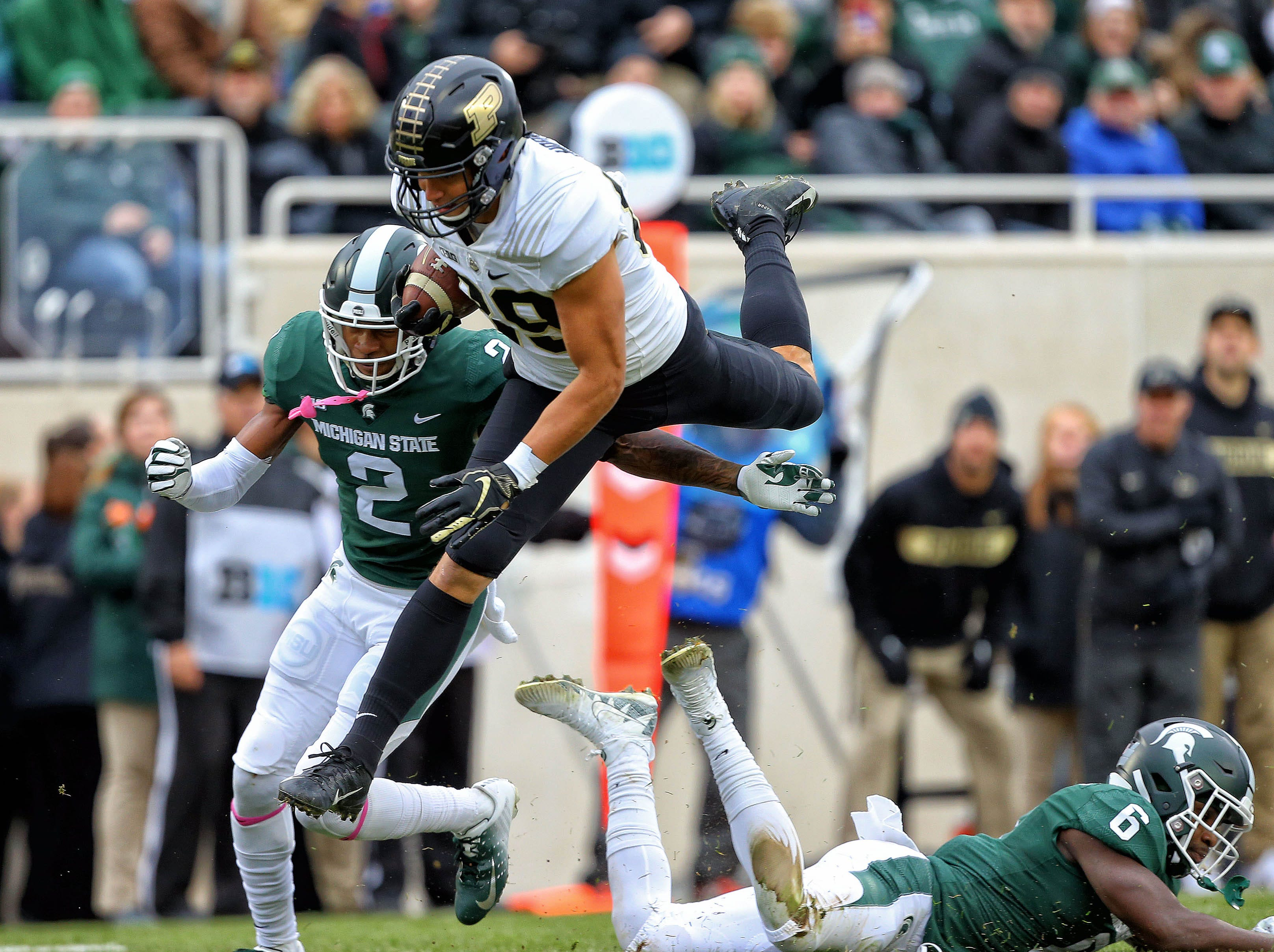 Oct 27, 2018; East Lansing, MI, USA; Purdue Boilermakers tight end Brycen Hopkins (89) hurdles Michigan State Spartans safety David Dowell (6) during the first quarter of a game at Spartan Stadium. Mandatory Credit: Mike Carter-USA TODAY Sports
