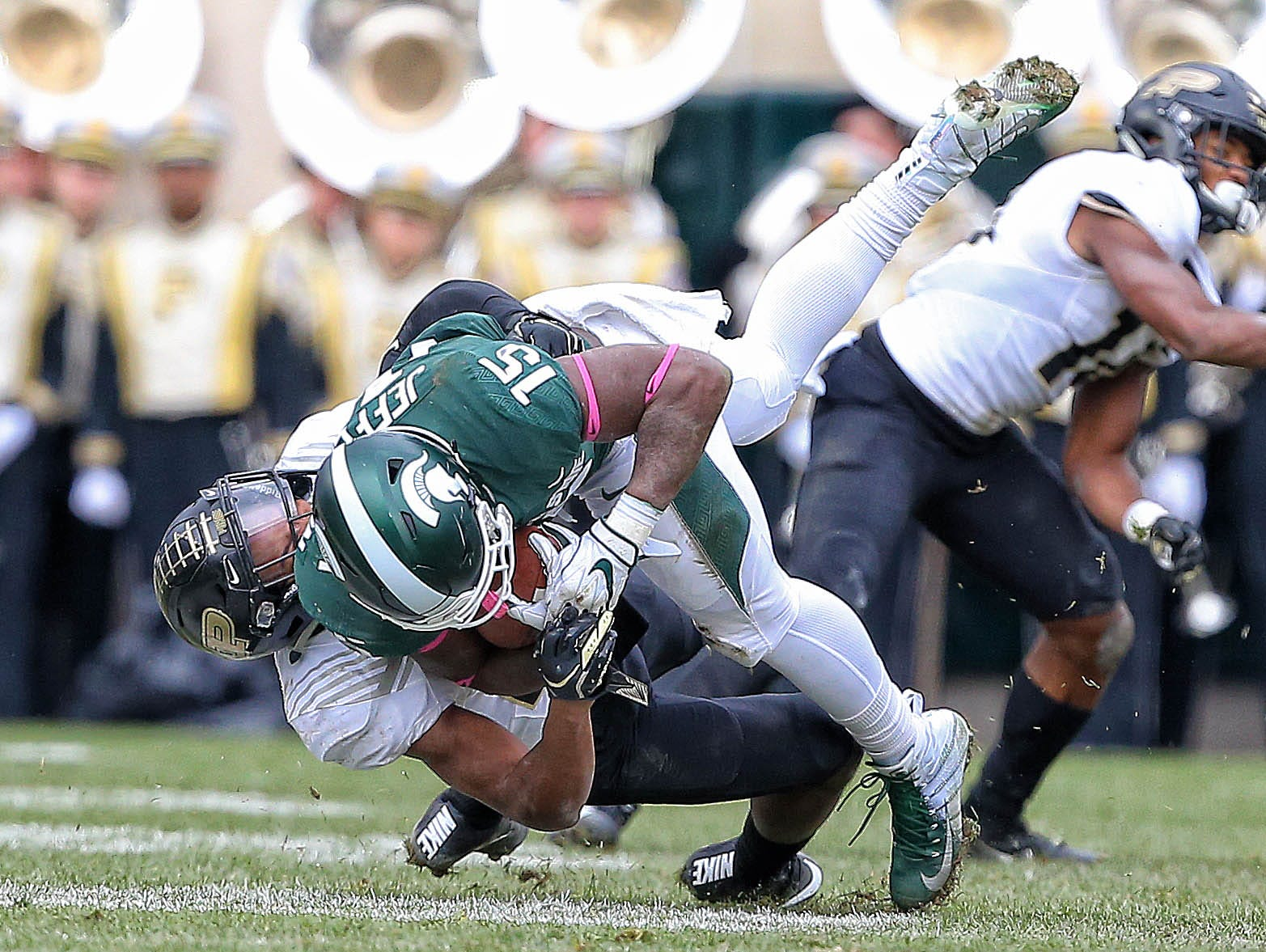 Oct 27, 2018; East Lansing, MI, USA; Michigan State Spartans running back La'Darius Jefferson (15) is tackled by Purdue Boilermakers safety Navon Mosley (27) during the second half of a game at Spartan Stadium. Mandatory Credit: Mike Carter-USA TODAY Sports