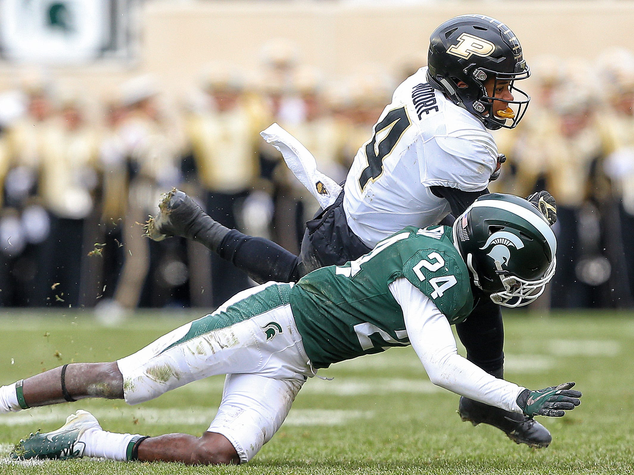 Oct 27, 2018; East Lansing, MI, USA; Purdue Boilermakers wide receiver Rondale Moore (4) runs against Michigan State Spartans safety Tre Person (24) during the second half at Spartan Stadium. Mandatory Credit: Mike Carter-USA TODAY Sports