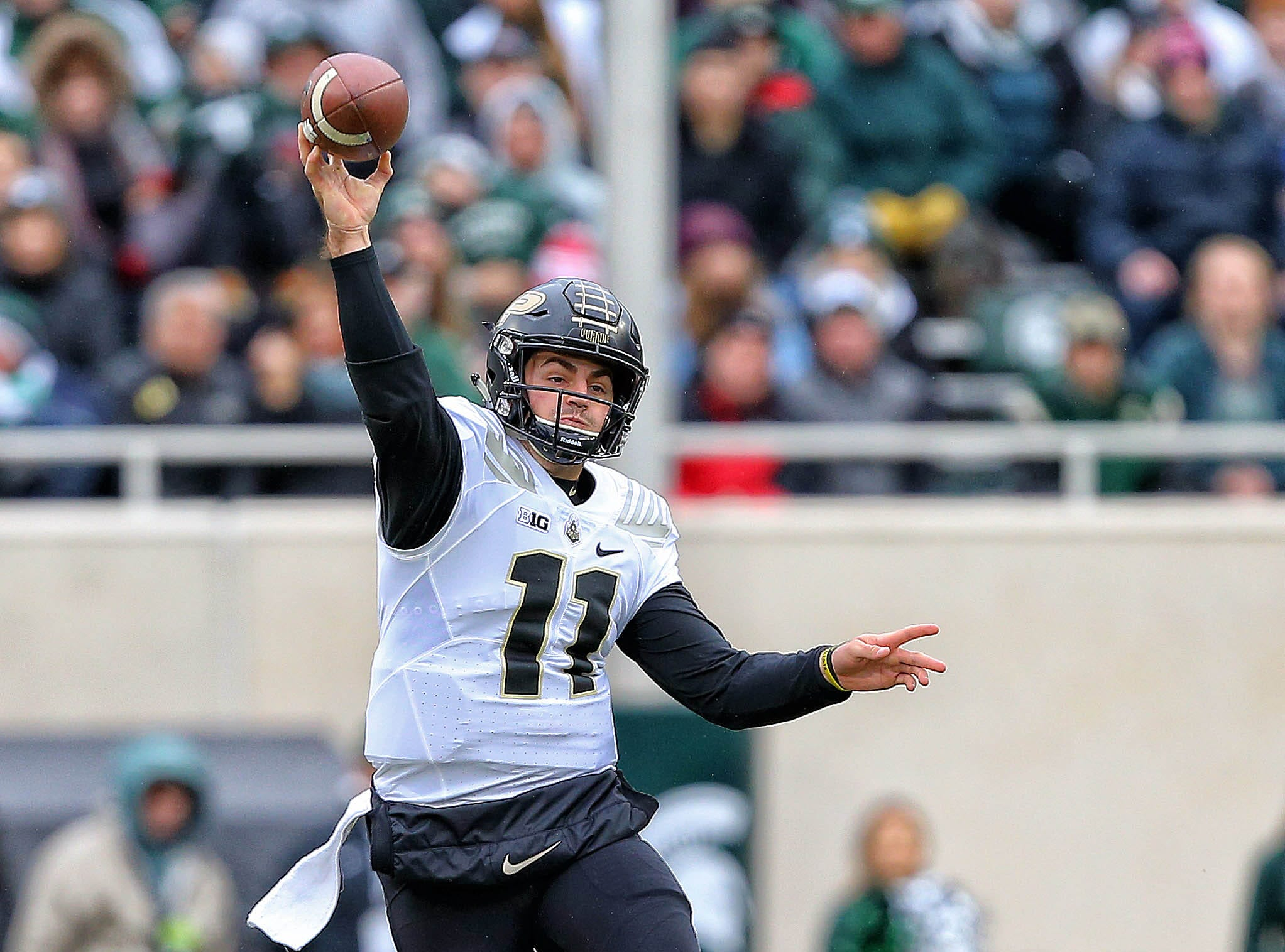 Oct 27, 2018; East Lansing, MI, USA; Purdue Boilermakers quarterback David Blough (11) scrambles out of the pocket against the Michigan State Spartans during the first quarter of a game at Spartan Stadium. Mandatory Credit: Mike Carter-USA TODAY Sports