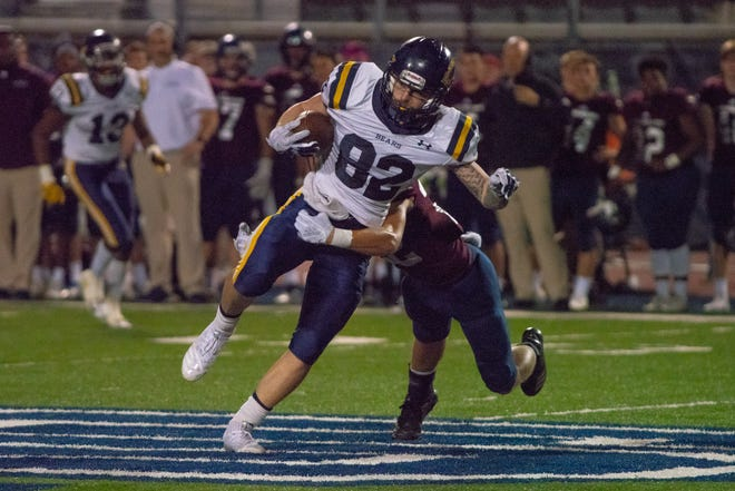 Carencro's Blake Lacombe hauls in one of his three receptions for the Golden Bears during last week's road loss at St. Thomas More.