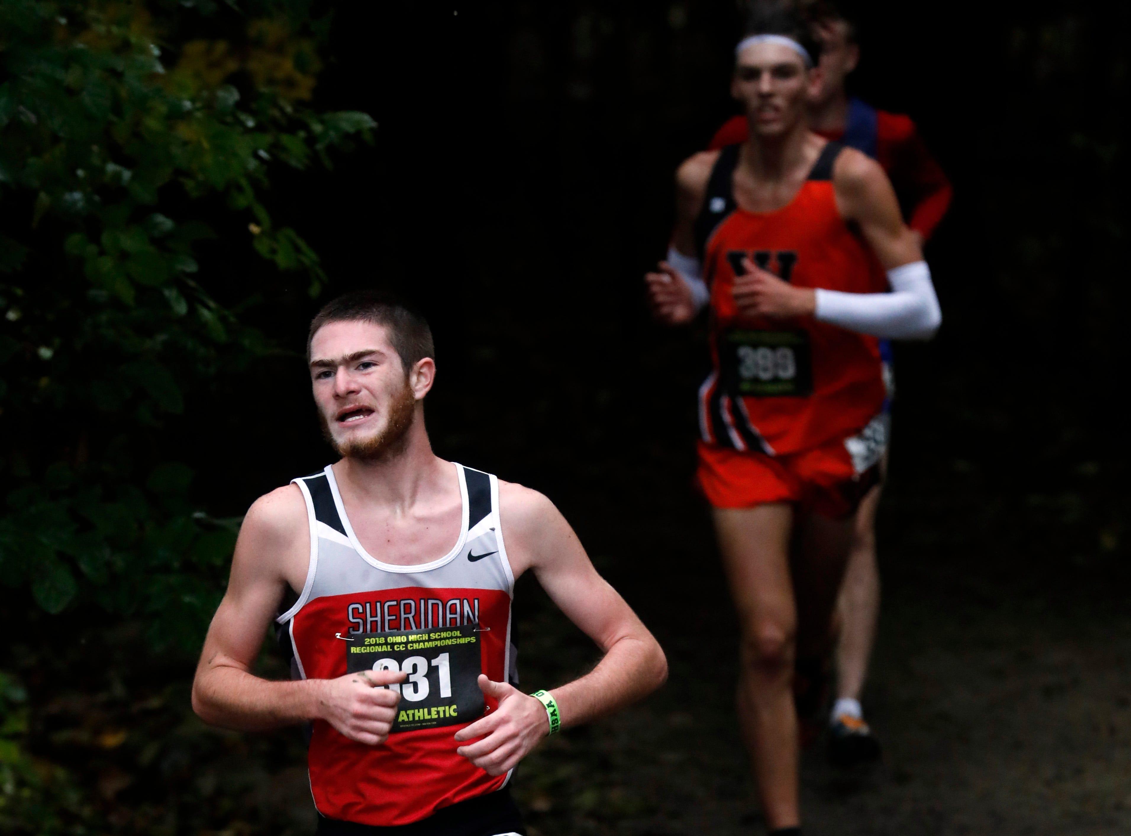 Sheridan's Luke Foster runs in the Regional Cross Country meet Saturday, Oct. 27, 2018, at Pickerington North High School in Pickerington.
