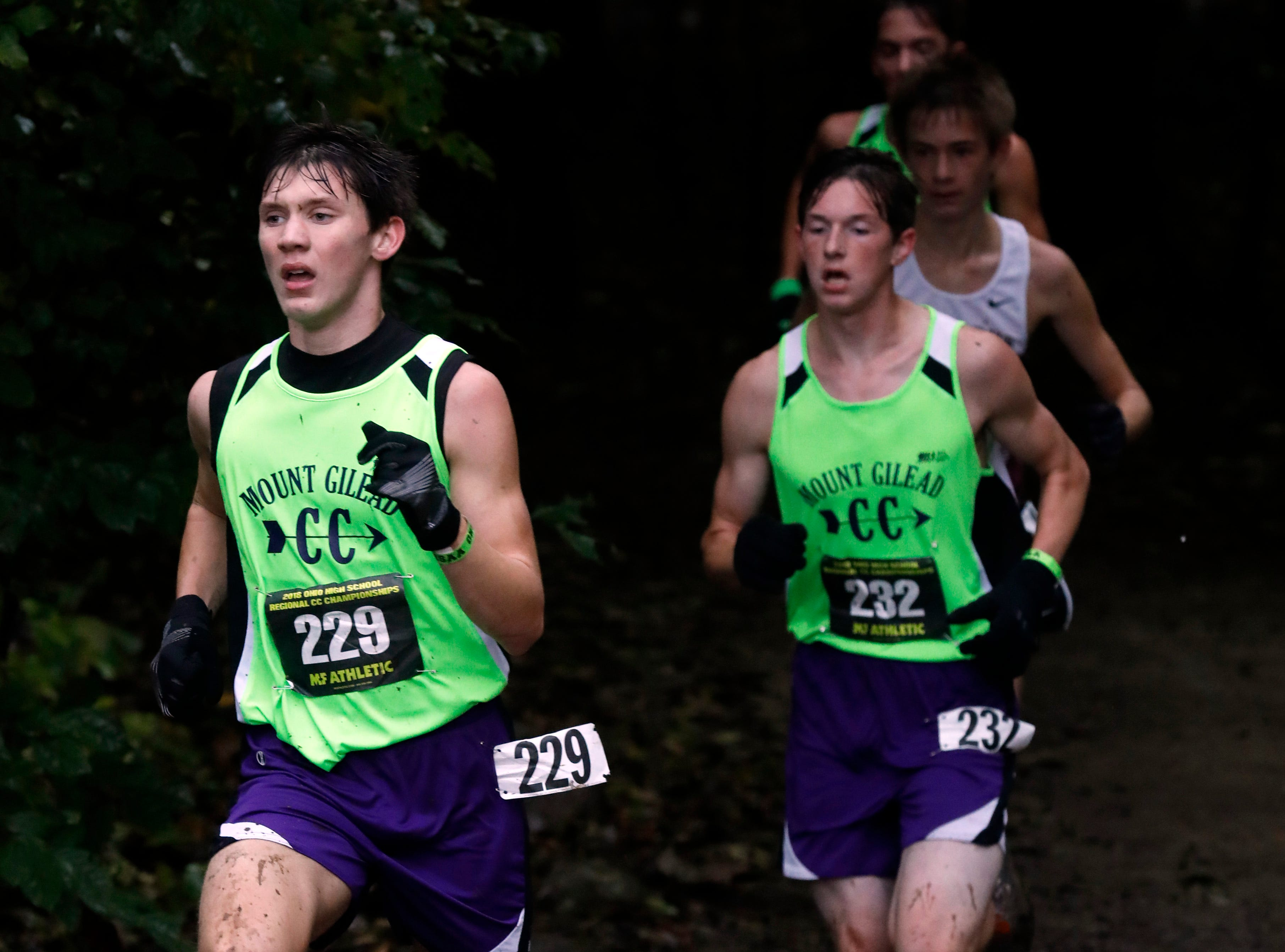 Mount Gilead's Liam Dennis, left, and Ethan Supplee run in the Regional Cross Country meet Saturday, Oct. 27, 2018, at Pickerington North High School in Pickerington.