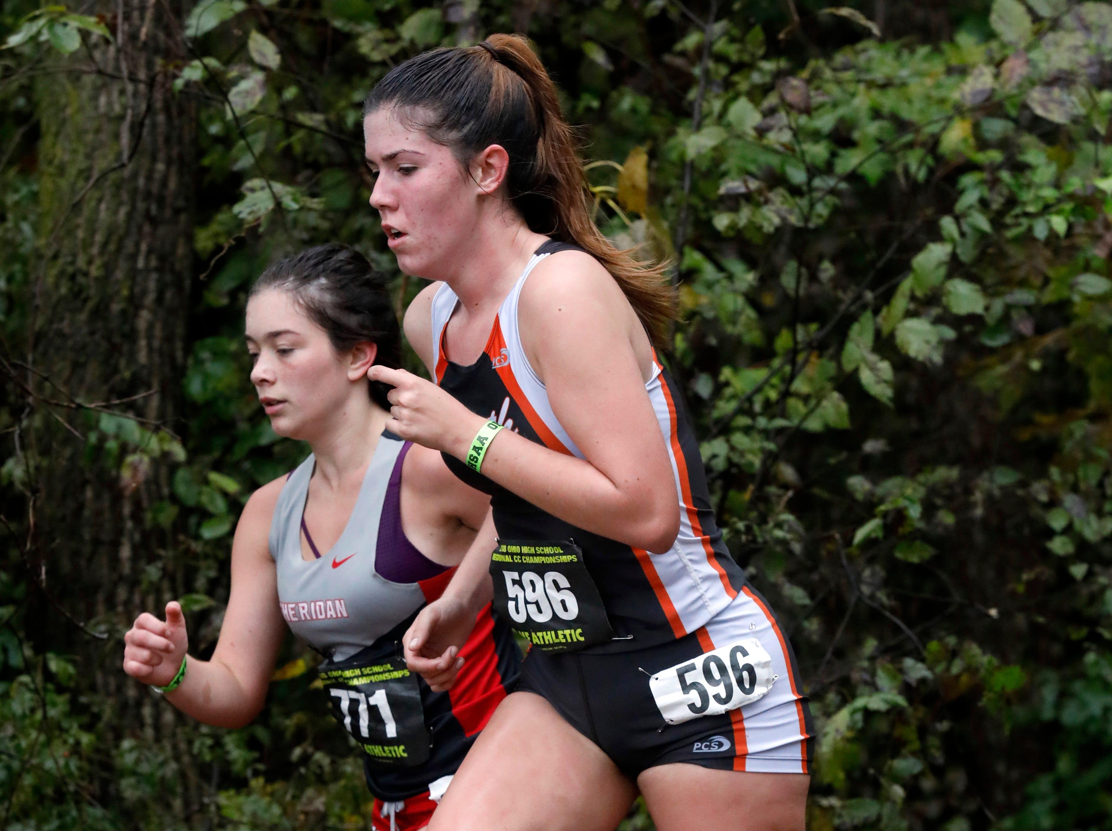 Sheridan's Ondrianna Nihiser, left, and Heath's Haylee Watson run in the Regional Cross Country meet Saturday, Oct. 27, 2018, at Pickerington North High School in Pickerington.