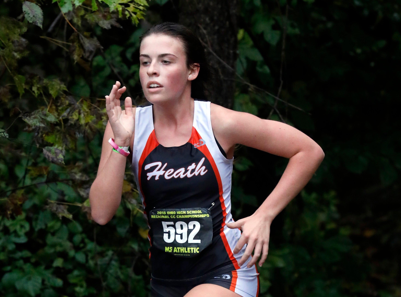 Heath's Skylar Daugherty runs in the Regional Cross Country meet Saturday, Oct. 27, 2018, at Pickerington North High School in Pickerington.