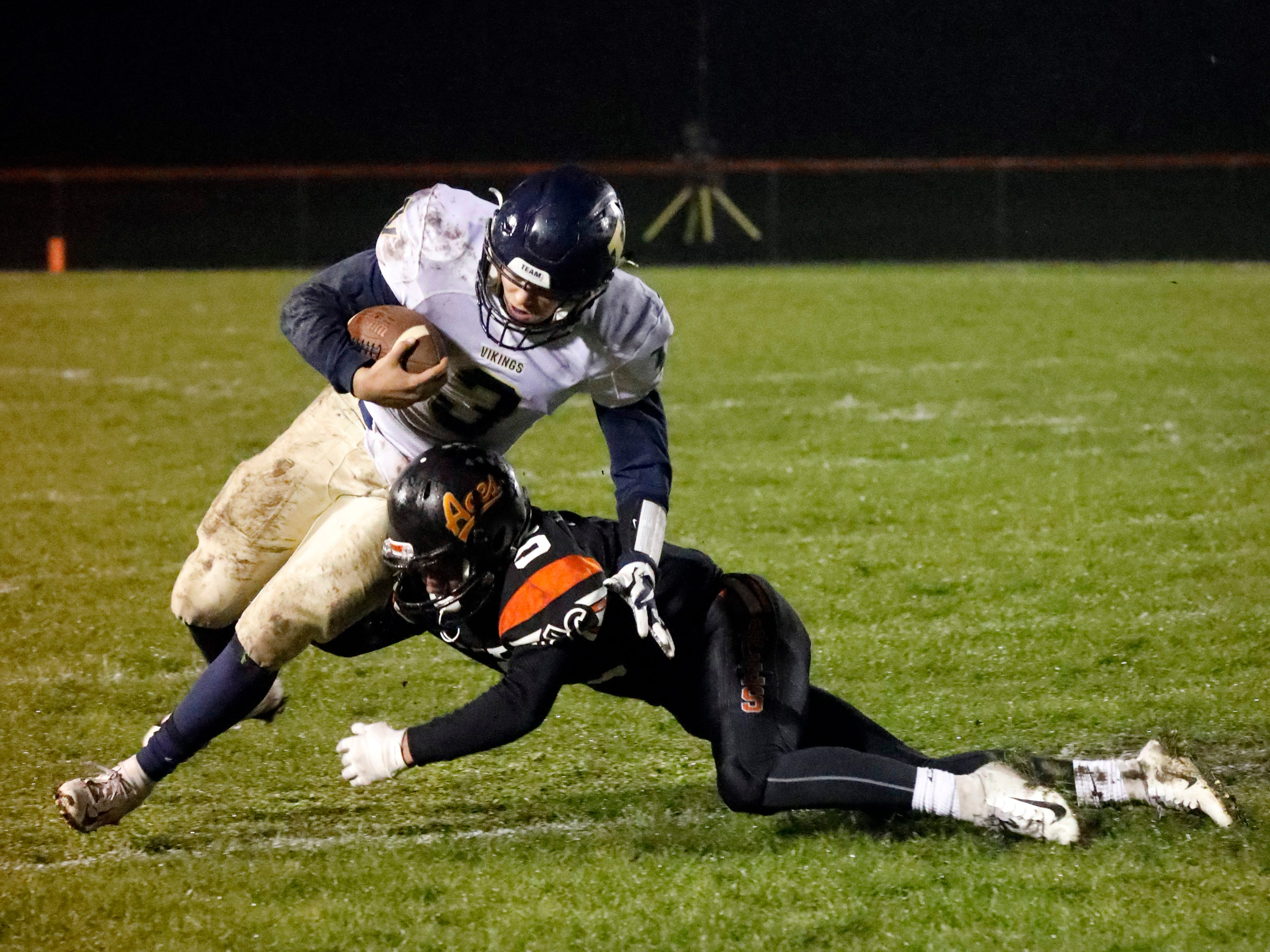 Amanda-Clearcreek's Jayse Miller tackles Teays Valley's Tristan McDanel Friday night, Oct. 26, 2018, at Amanda-Clearcreek High School in Amanda. The Aces lost the Vikings 9-0.