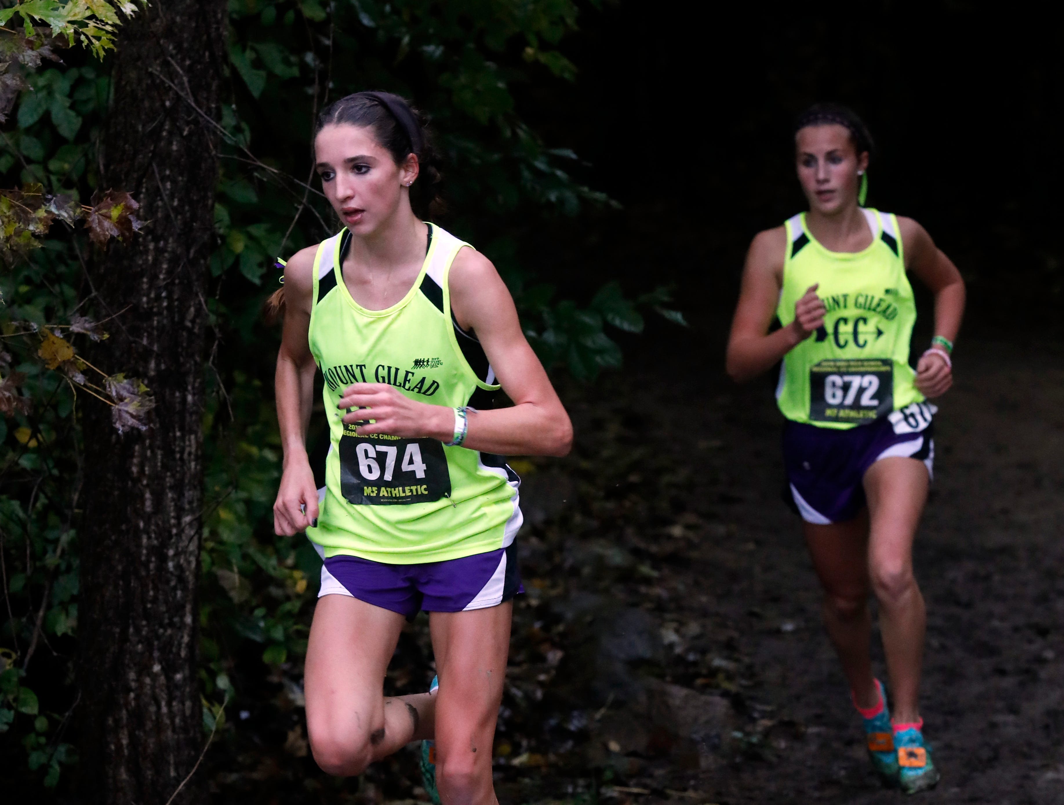 Mount Gilead's Allison Johnson, left, and Baylee Hack run in the Regional Cross Country meet Saturday, Oct. 27, 2018, at Pickerington North High School in Pickerington.