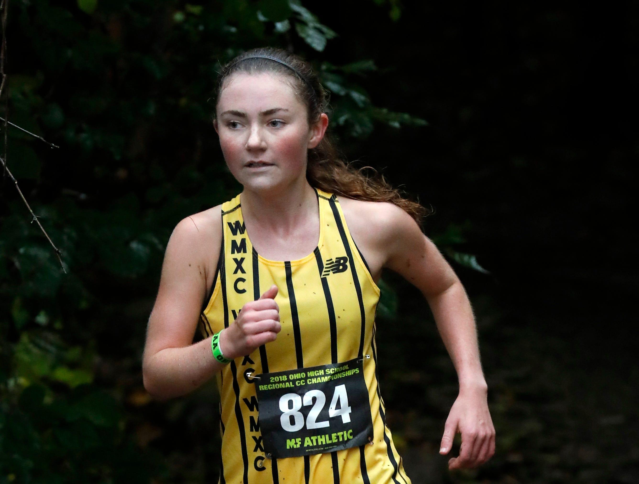 Watkins Memorial's Andrea Kuhn runs in the Regional Cross Country meet Saturday at Pickeringtion North High School.