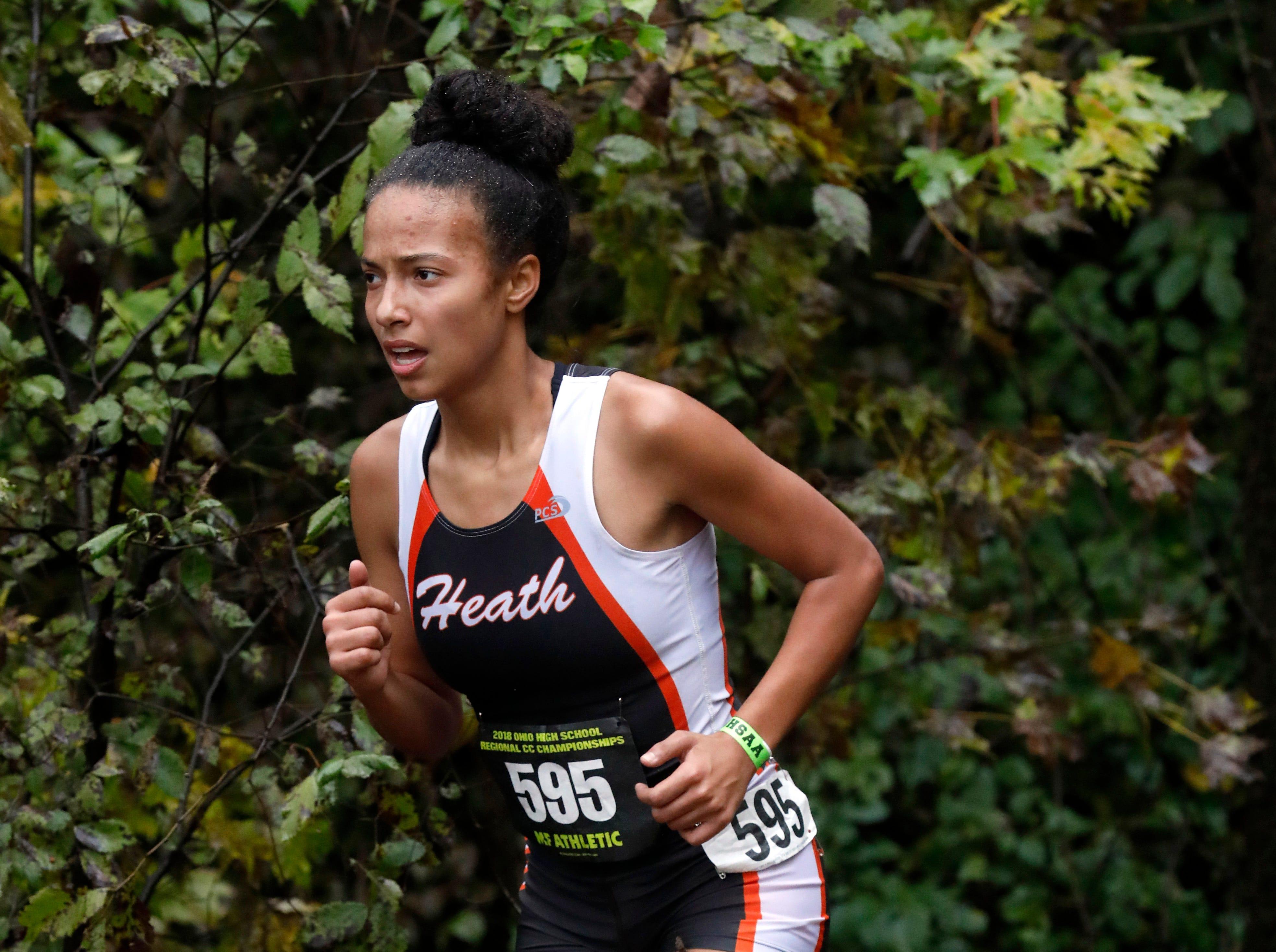 Heath's Arianna Spivey runs in the Regional Cross Country meet Saturday, Oct. 27, 2018, at Pickerington North High School in Pickerington.