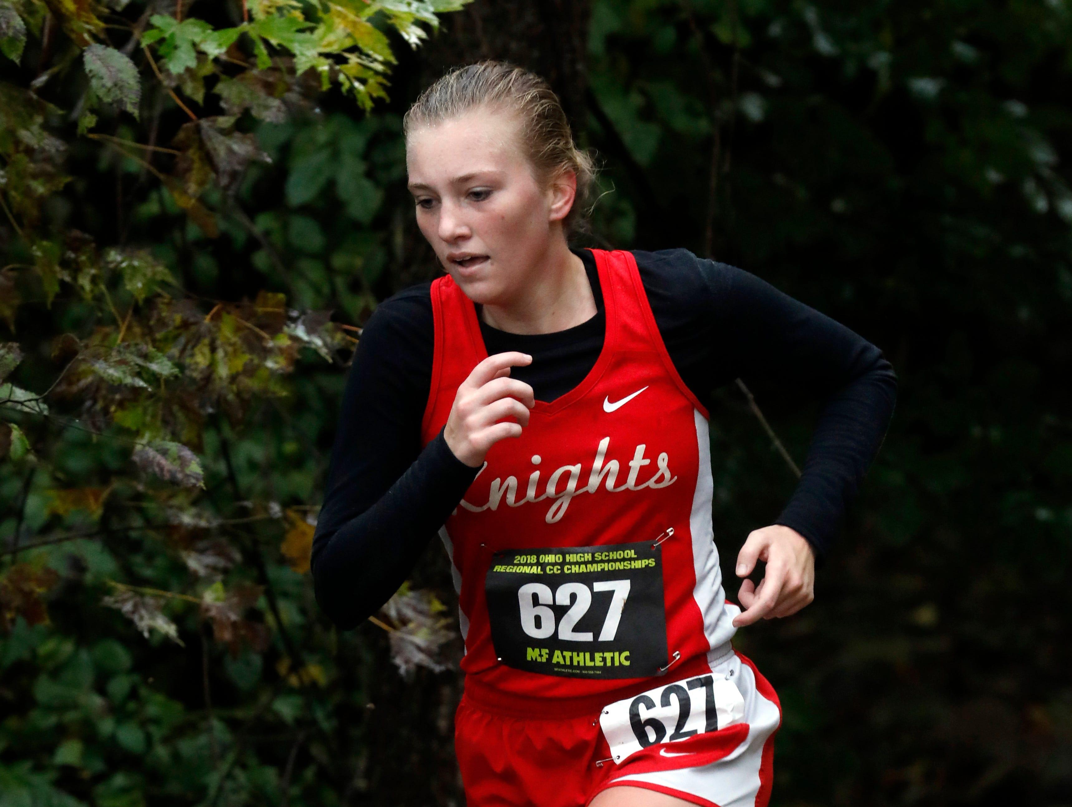 Fairfield Christian's Emma Seals runs in the Regional Cross Country meet Saturday, Oct. 27, 2018, at Pickerington North High School in Pickerington.