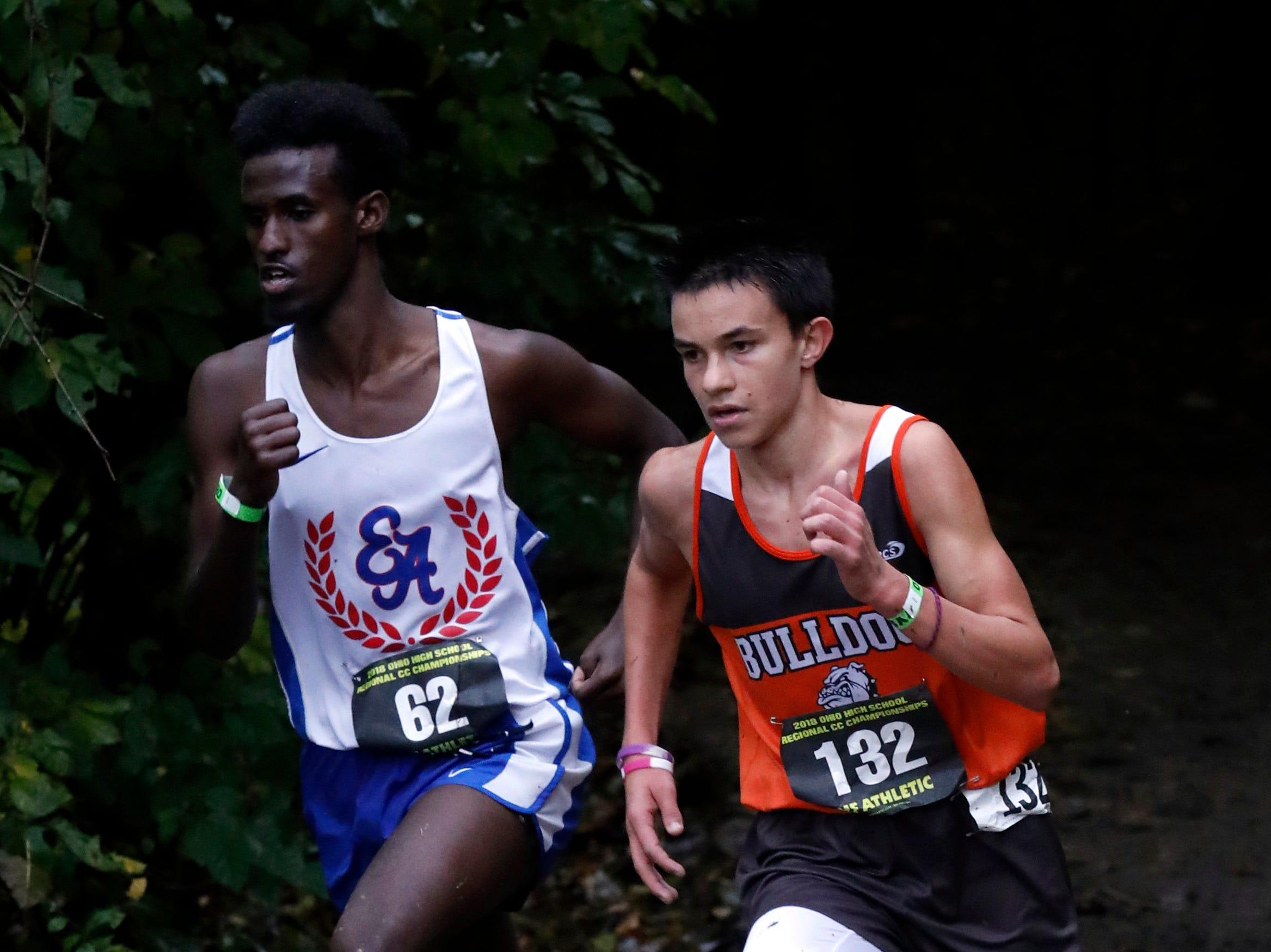 Heath's Xavier Foehl runs in the Regional Cross Country meet Saturday, Oct. 27, 2018, at Pickerington North High School in Pickerington.