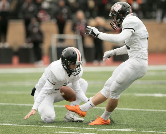 Paul Skoczylas of Brighton attempts a 41-yard field goal that would've tied the game in a 31-28 loss to East Kentwood on Saturday, Oct. 27, 2018.