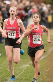 Erika Rapp, left, and Nyla Griffin of Pinckney approach the finish line in the regional cross country meet on Friday, Oct. 26, 2018.
