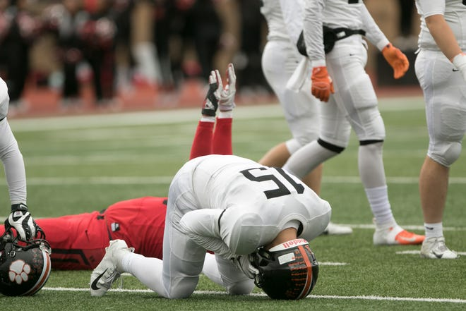 Brighton's Noah Piercy crumbles on the field after the Bulldogs' missed game-tying field goal attempt late in a 31-28 loss at East Kentwood on Saturday, Oct. 27, 2018.
