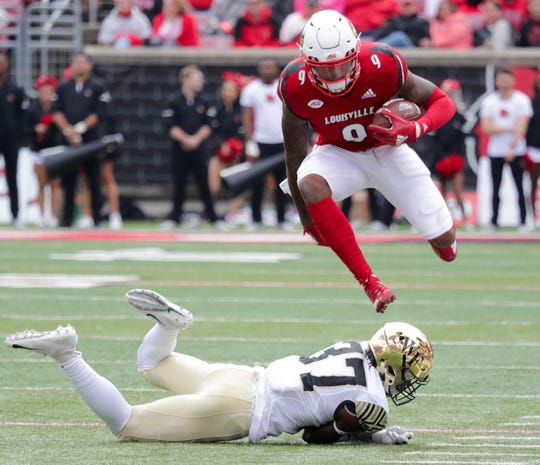 Louisville's Jaylen Smith jumps over Wake Forest's Nasir Greer.