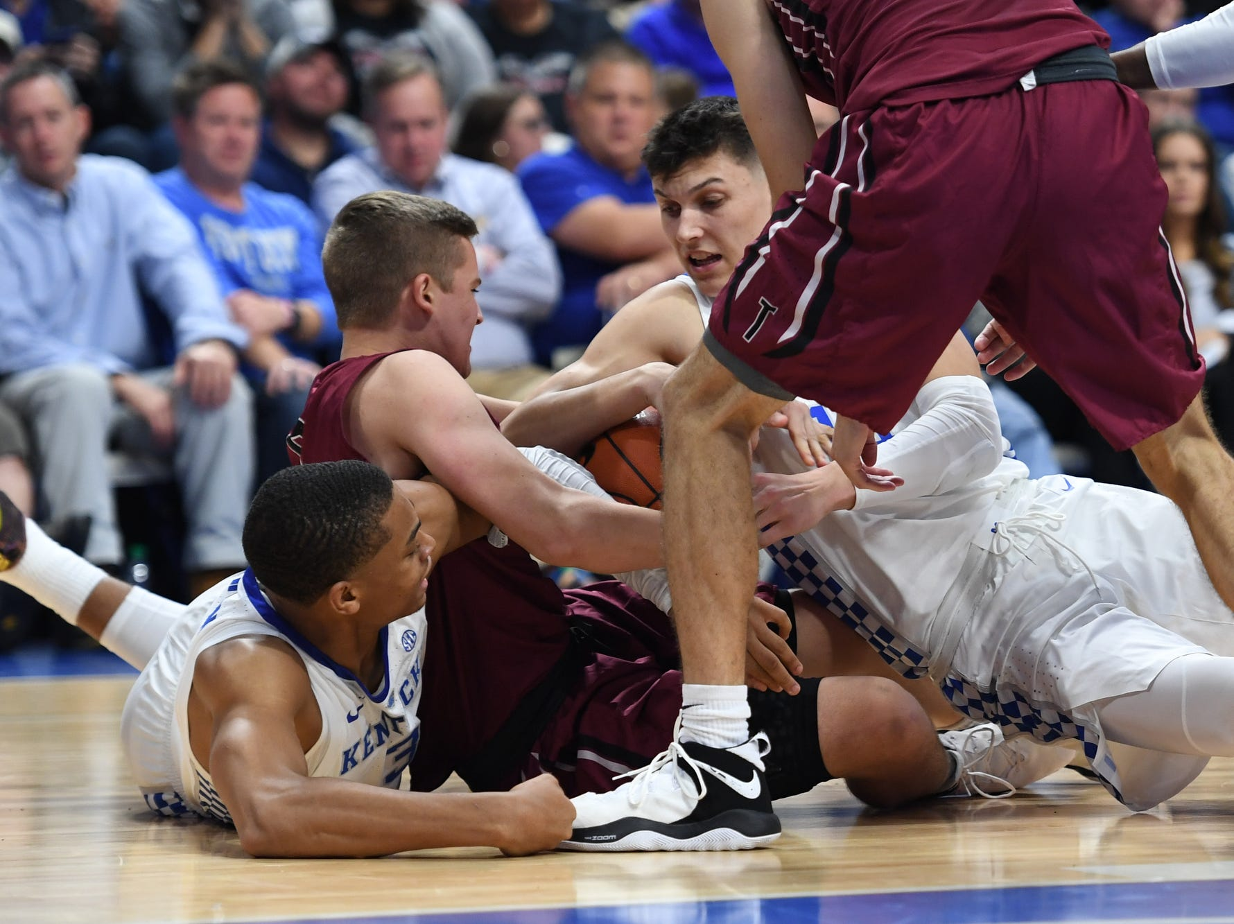 Tyler Herro grabs a loose ball during the University of Kentucky basketball game against Transylvania at Rupp Arena in Lexington on Friday, Oct. 26, 2018.
