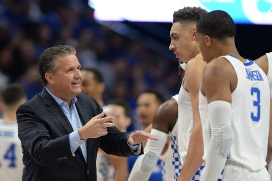 John Calipari talks with Reid Travis and Keldon Johnson during UK's exhibition vs. Transylvania.