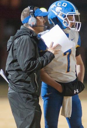 KCD head football coach Matthew Jones talks to his quarterback, Luke Russo . Oct. 25, 2018