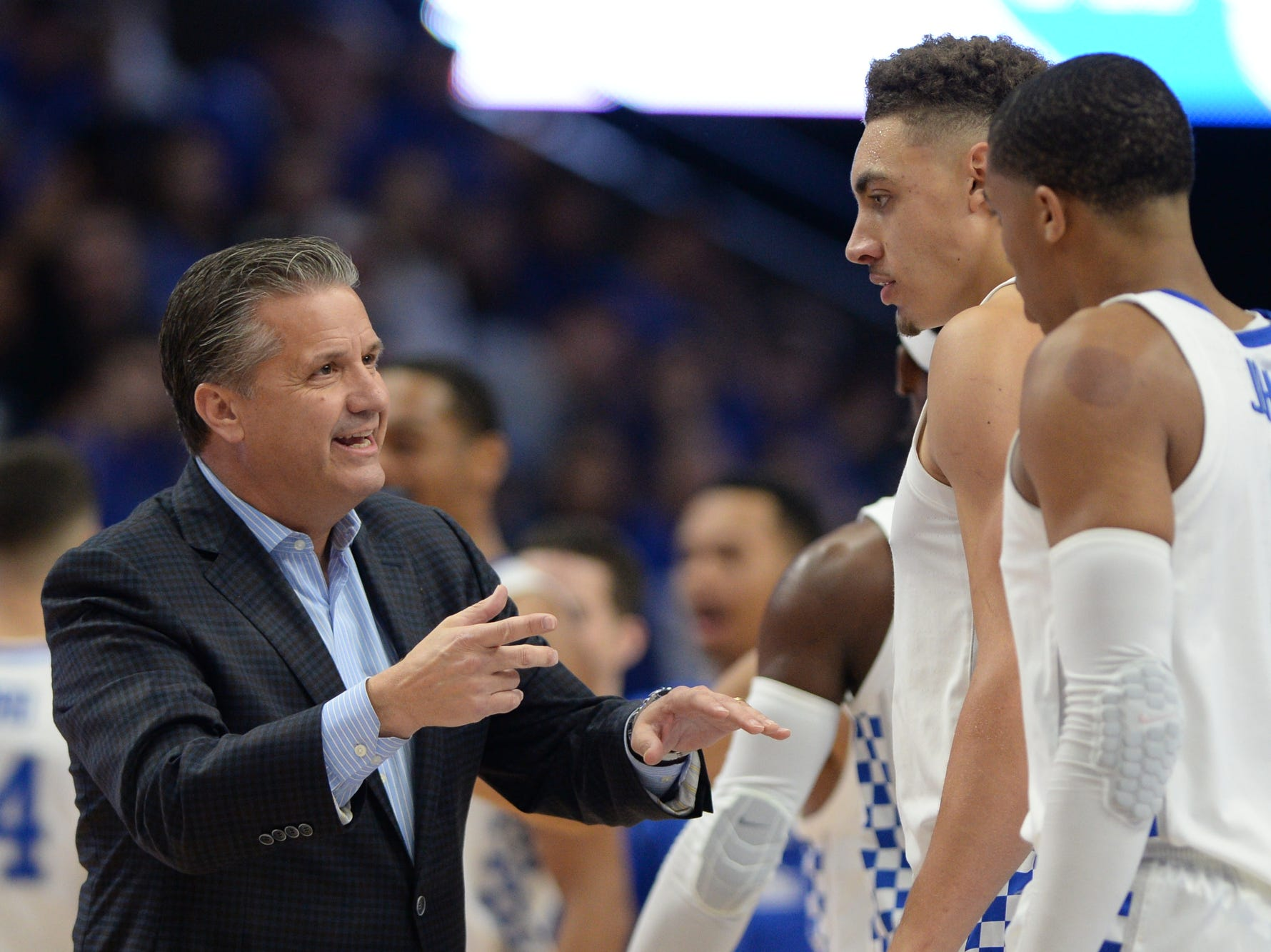 UK head coach John Calipari talks with Reid Travis and Keldon Johnson during the University of Kentucky basketball game against Transylvania at Rupp Arena in Lexington on Friday, Oct. 26, 2018.