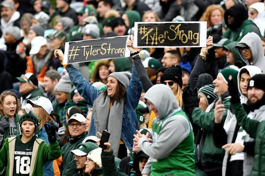 Fans show support for Purdue fan Tyler Trent, who is batting cancer, during the second quarter on Saturday, Oct. 27, 2018, at Spartan Stadium in East Lansing.